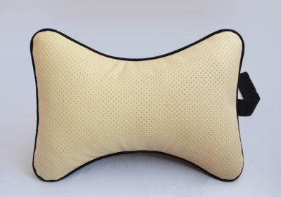 Подушка на подголовник из бежевой перфорированной экокожи